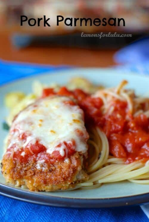 Pork Parmesan | Recipe on LemonsForLulu.com - Pork Parmesan is the new favorite substitute for chicken Parmesan!  Breaded pork chops are browned on the stove and finished in the oven.  Each chop is smothered in melted cheese and  homemade pasta sauce!