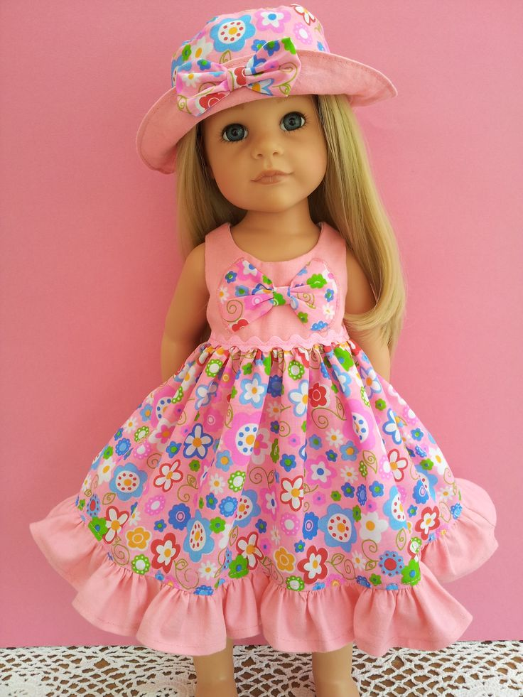 Bright summer flowers dress with frill and half-appliqued bow, with lined sunhat.  On Hannah Gotz.  Also fits American Girl.