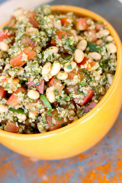 Tomato Basil Quinoa Salad: 2 c. prepared quinoa 1 can navy beans, drained and rinsed 3 1/2 c. – 4c. diced tomatoes 2 c. spinach 1 c. packed basil Dressing: 2 TB. balsamic vinegar, 1 TB. olive oil, 2-3 cloves garlic finely diced, zest of one small lemon, salt and pepper to taste, (parmesan cheese:optional)