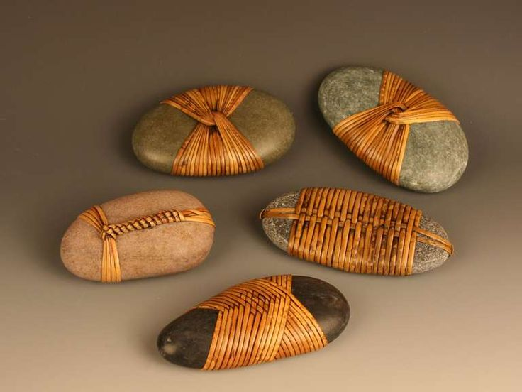 """Sculptures made from natural river stones with rattan woven in Japanese basketry techniques by Seattle area artist Del Webber (stone sculptures vary in size, approximately 4"""" x 2"""" x 1.25"""" up to 4.5"""" x 3"""" x 2.5"""")"""