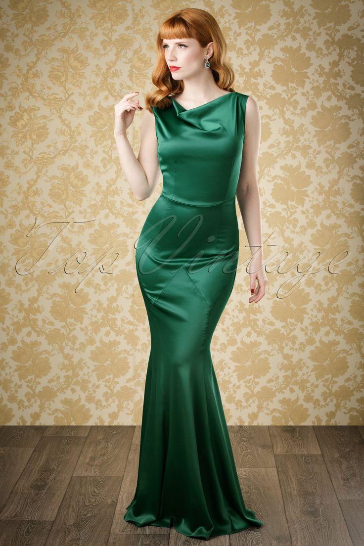 """Marilyn Monroe zei ooit: """"Everyone's a star and deserves to twinkle.""""In deze30s Ingrid Mermaid Dressbenjijdie stralende ster!Deze schitterende nauw aansluitende jurk is geïnspireerd op de avondjurken uit de jaren 30 en heeft klassieke diamantvormige inzetten op de heup en een elegante hooggesloten halslijn die doorloopt in een sexy diepe V op de rug. Dat is nog niet alles... de prachtige mermaid style rok geeft je dat felbegeerde zandloper figuur..."""