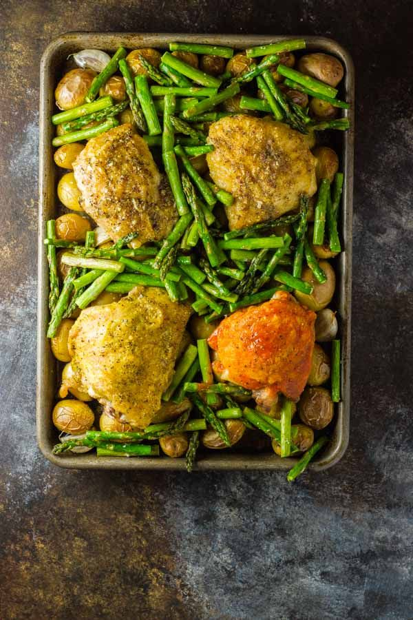 One-pan oven baked chicken thighs with potatoes & a side, plusa simple technique that allows for a different flavor chicken for each member of the family!