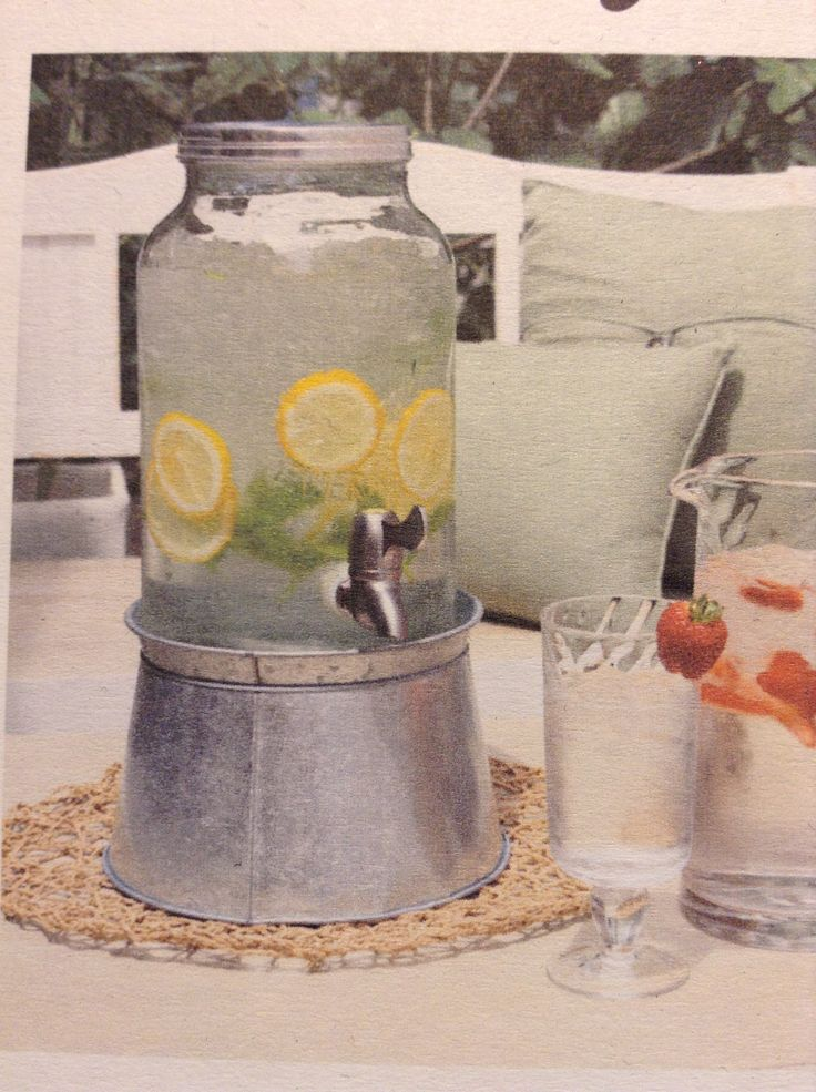 Gorgeous mason jar drink dispenser! Now in stock and only $50 including rustic tin stand!