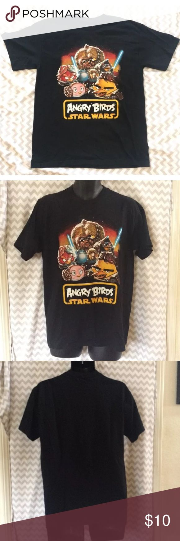 Star Wars Angry Birds T-Shirt Adult Size Medium Angry Birds: Star Wars edition graphic t-shirt by Fifth Sun, unisex adult size medium. Black with graphic design depicting the main characters from Star Wars as the popular Angry Birds. The shirt is in very gently used condition, with no stains or rips.  Measurements- Chest: 19 in. Length: 28 in. Sleeves: 7.5 in. Shoulders: 19 in. Fifth Sun Shirts Tees - Short Sleeve
