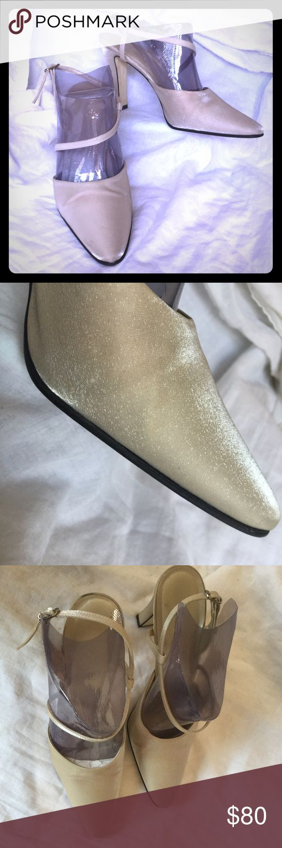 Nine West iridescent champagne heels I fell in love with these shoes when I found them. Champagne colored w/a sheen that reflects light, these are more interesting than your ordinary shoes. Worn once for an outdoor wedding, the bottom of the heels have evidence of walking outside. There are a few marks, but none are visible when wearing them. They have been hanging in a box for a while & the inside of the straps are flaking a bit. If I kept them, I would just brush it away & I think clear…