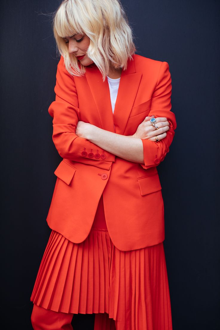 Pandora Sykes wearing a Stella McCartney suit and skirt and Gucci loafers