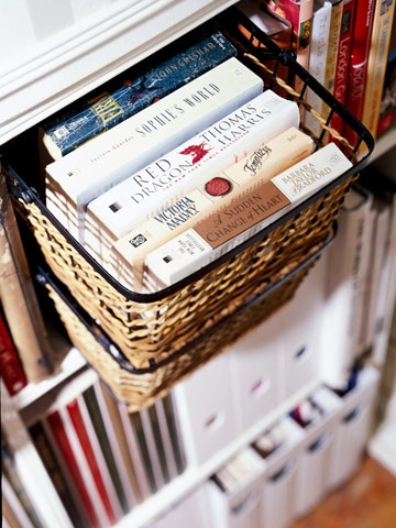 Repurpose wire and wicker kitchen storage pieces -- such as these pullout vegetable baskets -- to organize clusters of paperbacks in an unconventional manner.