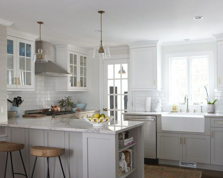 Bianco Macabus Quartzite counters, Benjamin Moore Cape May Cobblestone on lowers, sconces
