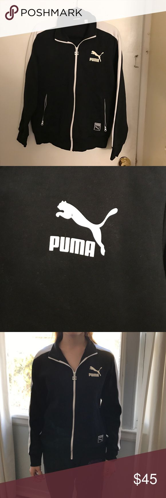 A Puma sweatshirt It's a black Puma sweatshirt with white strips going down both arms. Puma Jackets & Coats
