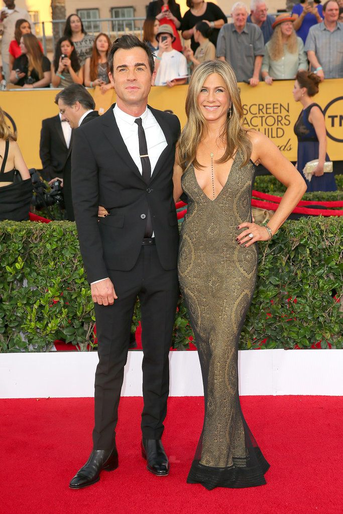 Jennifer Aniston and Justin Theroux pose on the red carpet at the SAG Awards.