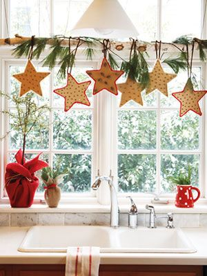 Window Swag  Cut freehand stars out of cardboard (or enlarge and use the star template). Poke cloves through in random patterns, then glue red or white yarn around edges. Hot-glue pipe cleaners to the back, form into hooks and hang from a birch bough from your backyard rested on the window frame.