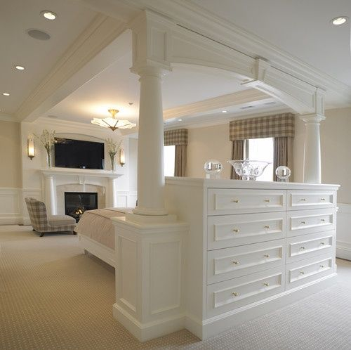 Built-in dresser with back that serves as the headboard for the bed. love this open space feel. Now that's a master bedroom