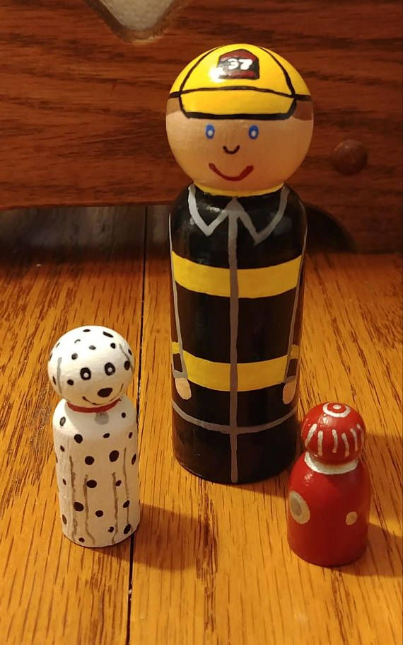 Hand painted wood peg doll Fire Fighter is 3 9/16 tall Dalmatian is 1 11/16 tall Hydrant is 1 1/8 tall A female form is available upon request in the 3 1/2 dress style. Or the straight style like shown can be painted as a female with longer hair. Each set is hand painted to order.