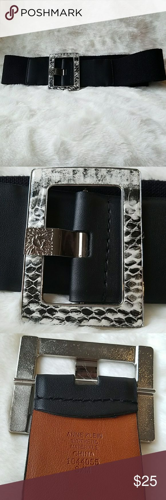 Anne Klein stretchy wide belt. Faux snake buckle. Anne Klein wide belt. Faux snake buckle. Stretchy back. Faux leather belt hole portion. Perfect for waist cinching with any dress, especially shift dresses and with tunics. Black. Excellent condition. Size S/M Anne Klein Accessories Belts
