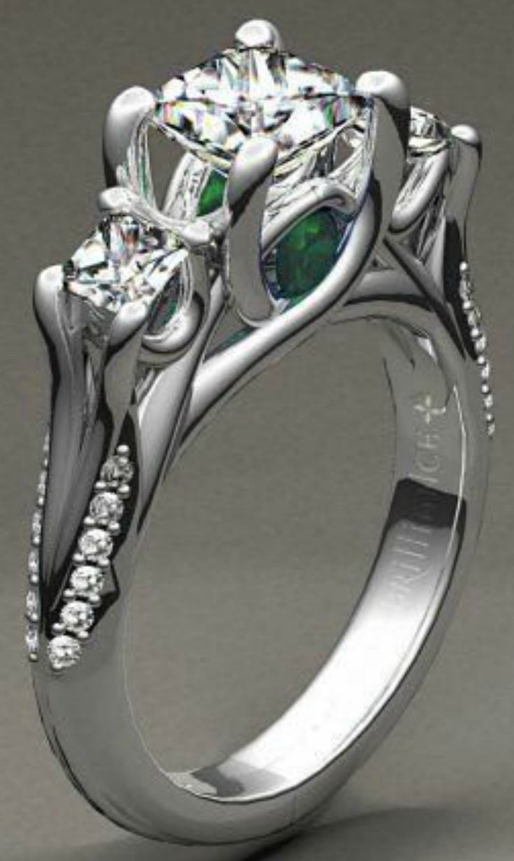 Beautiful custom diamond engagement ring with a gorgeous emerald gemstone!