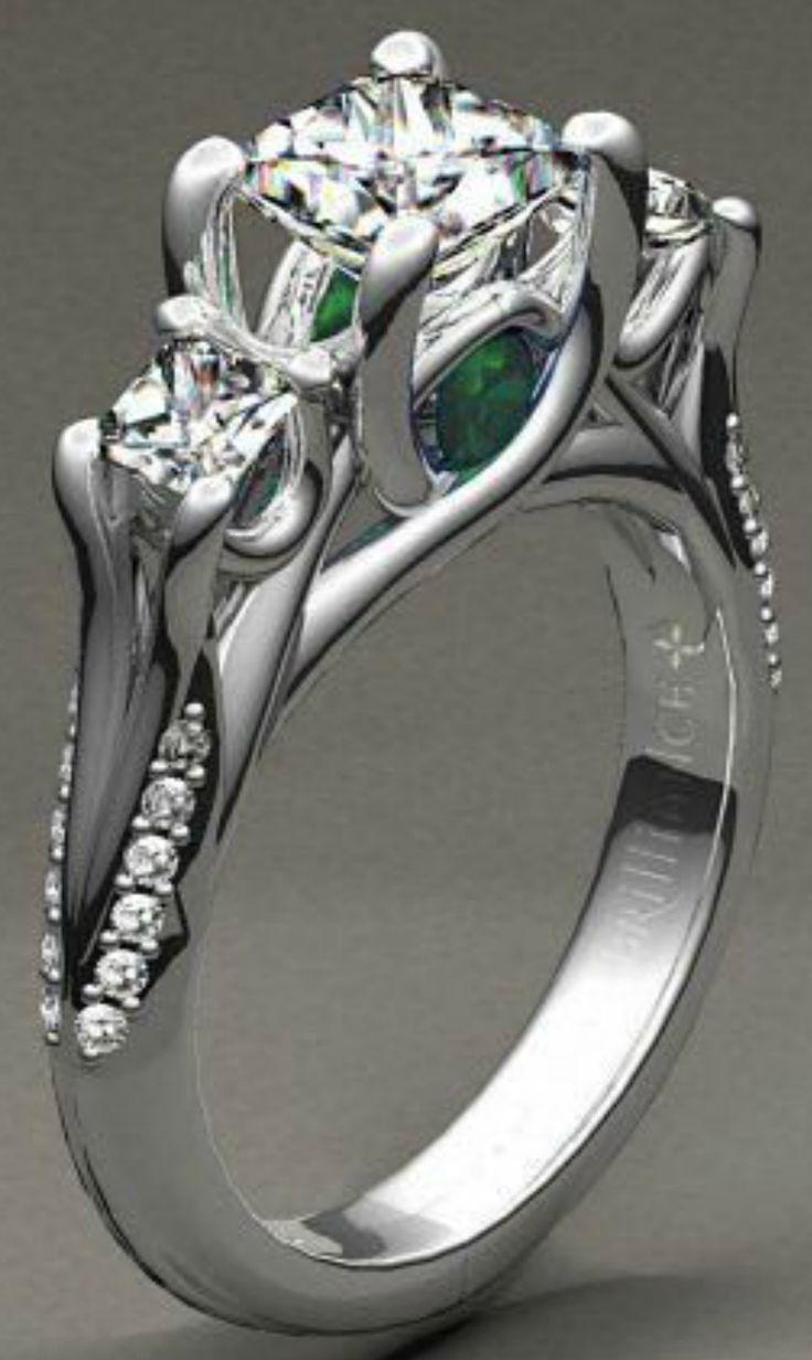 Beautiful custom diamond engagement ring with a gorgeous emerald gemstone!