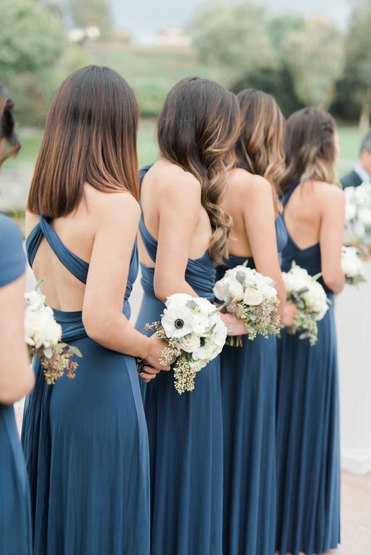 Bridesmaids dresses ideas - blue / navy bridesmaid dress with white florals. Such a great color fit for the bridal party for a winter wedding (and we got some rain that day and it still looked gorgeous!) www.anyakernesphotography.com (Fine art wedding photographer in Los Angeles)