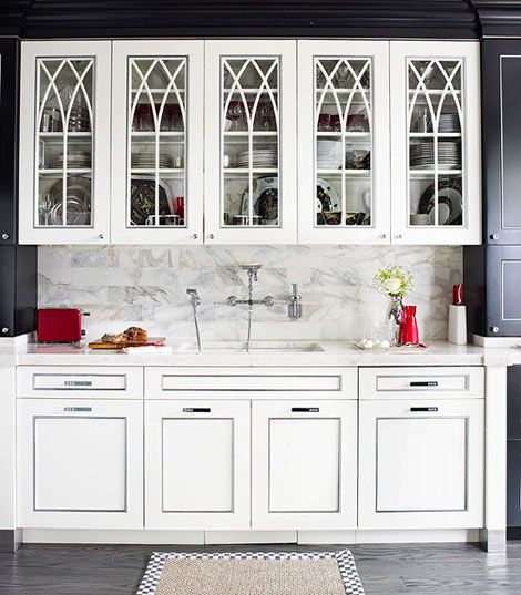 White kitchen cabinets with gothic arch glass front doors for Beveled glass kitchen cabinets
