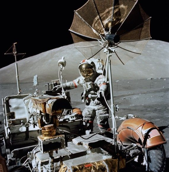 """Apollo 17 commander Eugene Cernan with the lunar rover in December 1972, in the moon's Taurus-Littrow valley. (Credit: NASA) Ian Ridpath, """"Exploring the Apollo Landing Sites"""" http://www.bellaonline.com/articles/art29536.asp"""