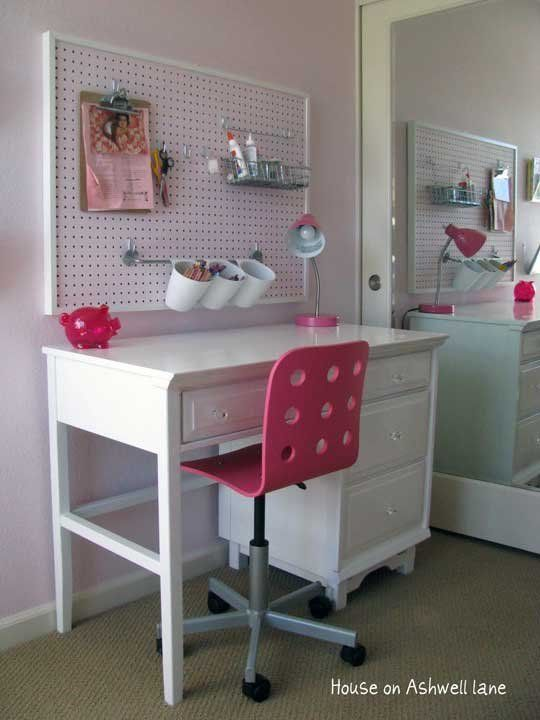 When I think of pegboard, I usually imagine it in a garage or basement, but I'd much rather conjure up a pretty picture like this one of a young girl's desk.