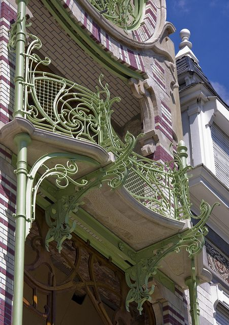 Classic Belgian Architecture. Art Nouveau building in lovely colors by architect Gustave Strauven, called Maison Saint-Cyr, Brussels.