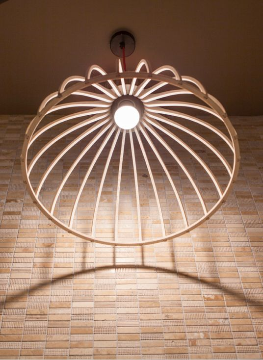 Wooden fin pendant light from Jacques Cronje. Featured at Nando's Gateway.