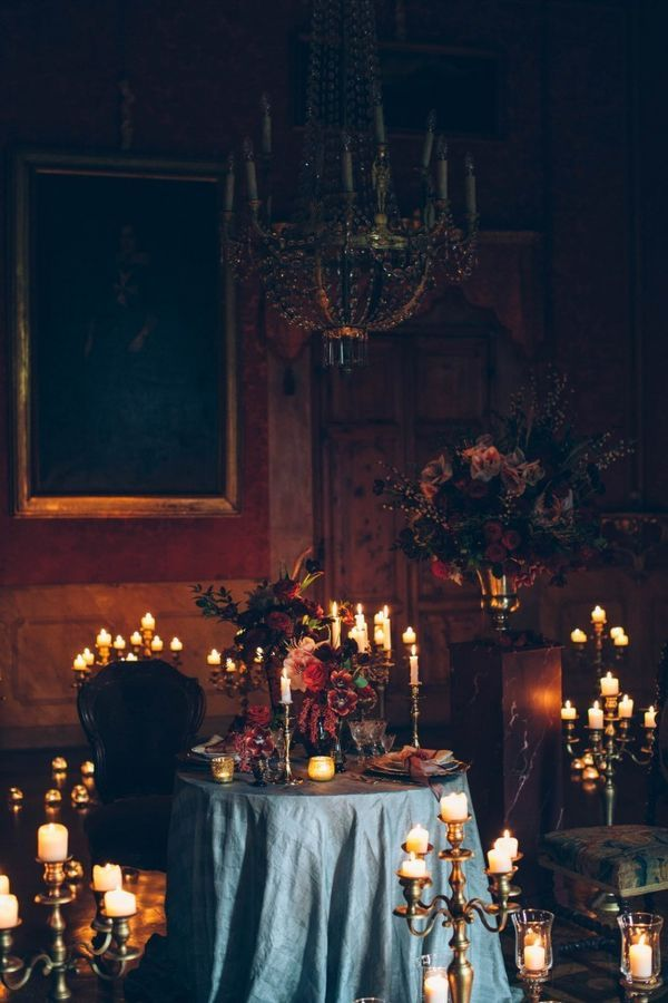 """Candle Decorations: Candlelight and weddings go together like peanut butter and jelly. But for a Halloween wedding you need to bring new meaning to """"over the top."""" Cover every surface with candles in unique holders to create a holiday-appropriate mood for your celebration."""