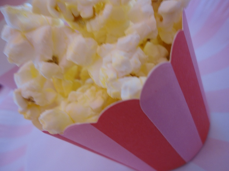 Using the leftover cupcake cups, fill them with popcorn. It's just the right amount for little kiddies