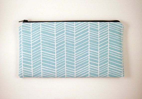 "Blue Herringbone Zipper Pouch Make Up Bag Pencil. This blue herringbone zipper pouch measures approximately 9 1/4"" by 5"". It makes a lovely daytime make up bag, pencil pouch, or gadget bag.  The exterior is light blue / aqua herringbone cotton fabric. White lines form a chevronish pattern on a light blue background The interior is gray Kona cotton. The pouch's closure is a 9"" black YKK zipper."