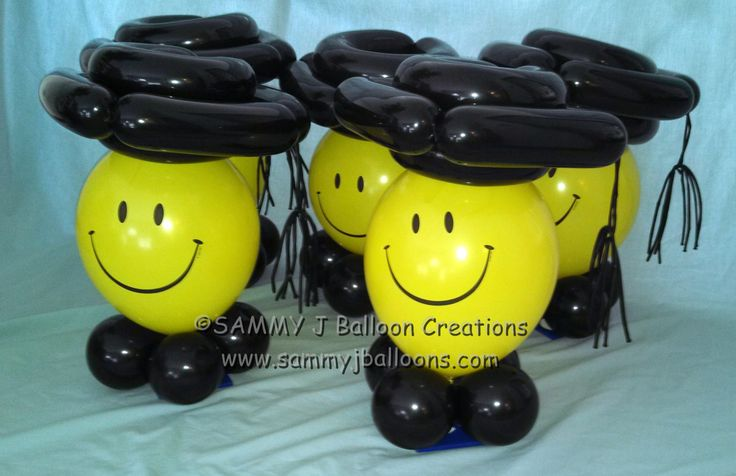 These smiling graduates make great centerpieces for the diploma recipient party!    www.sammyjballoons.com