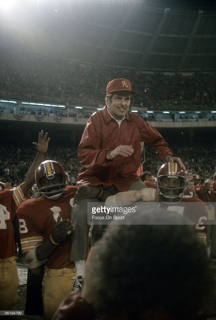 Head Coach George Allen of the Washington Redskins is lifted up on the shoulders of his players after the Redskins defeated the Dallas Cowboys in the NFC Championship Game on December 31, 1972 at RFK Stadium in Washington, D.C.. The Redskins won the game 26-3. Allen coached the Redskins from 1971-77.