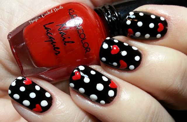 Another Valentine mani; white dots on black background with little painted hearts! Too cool!