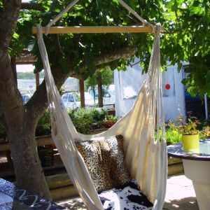 A natural Ibizan Chill Chair outside, perfect for relaxation! chillchairs.co.uk #hammockchairs #chillchairs