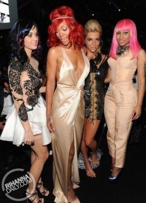 Rihanna wearing Jennifer Behr Single Baguette Crystal Headwrap and Gucci Silk Gown.