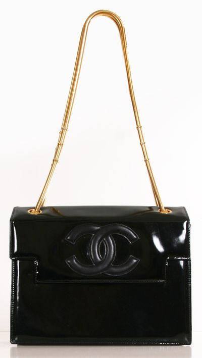 """Chanel Black Patent Leather Vintage Hand-Bag with Gold Hardware Straps. A signature vintage Chanel with the iconic Chanel logo on the clasp. Beautiful structured and symmetrical. Versatile for any evening occasion. Gold coiled chains had a bold accent to the bag. 10"""" x 8"""" x 20"""""""