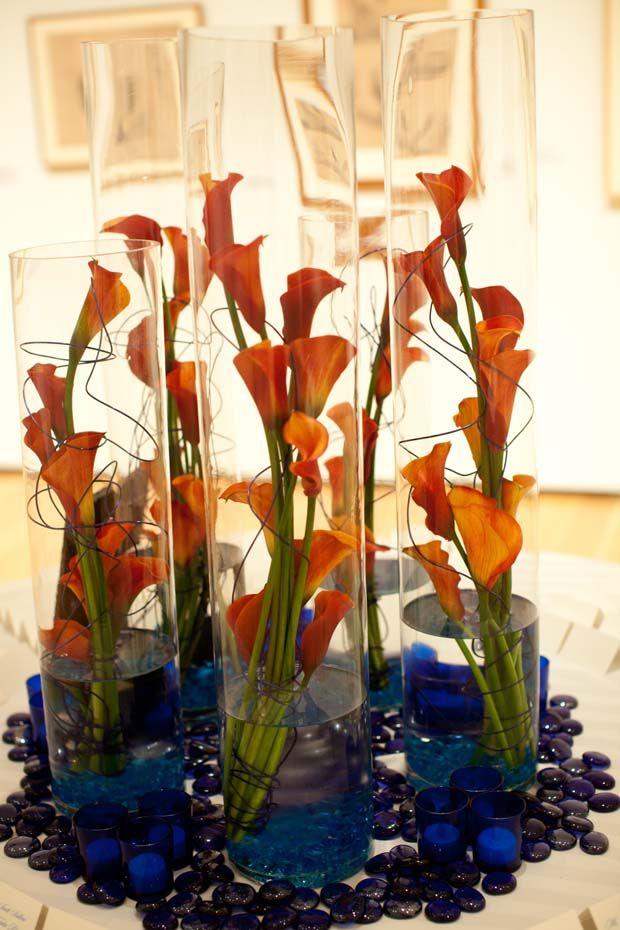 Orange Calla Lilly w/ wires, modern table arrangement, blue accents