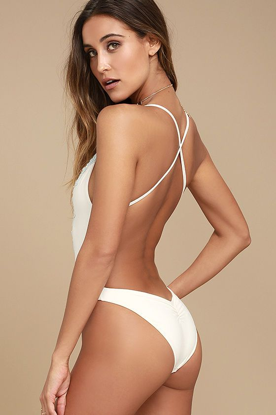 A day in the sand and the waves is destined to be accompanied by the Blue Life Eclipse Cream One Piece Swimsuit! A plunging V-neckline dives between beautiful, scalloped, light blue lace, topped by adjustable spaghetti straps that crisscross over an open back. Attached bottoms have gathered detail at back, giving them a flirty, cheeky shape. PLEASE NOTE: Swimwear returned without the hygienic liner is non-refundable.