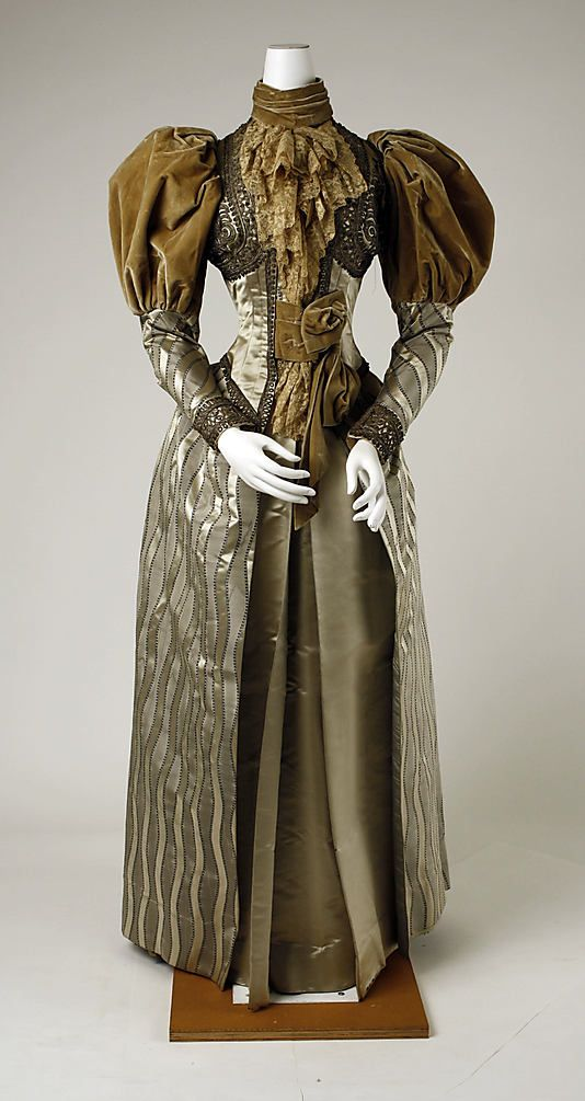 Dinner Dress, circa 1894 Gigot or leg-of-mutton sleeves are full at the shoulder, gradually decreasing in size to the wrist where they ended in a fitted cuff.