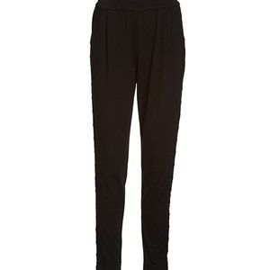AISHA loose pants w lace, black. Beautiful pants w lace along the leg. A reinterpretation of our most popular model.  We recommend that you buy this pair of pants in a size smaller than usual.