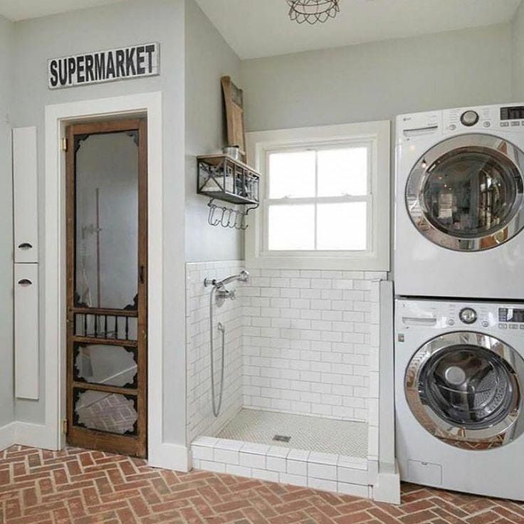 Dog Shower With Shelves And Hanging Hooks Next To Stacked Washer Dryer In 2020 Laundry Room Remodel Mudroom Laundry Room Dream Laundry Room