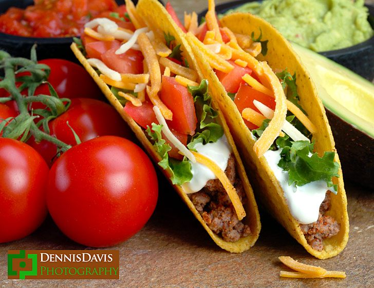Two tacos with tomatoes on the vine, California Avocados, salsa
