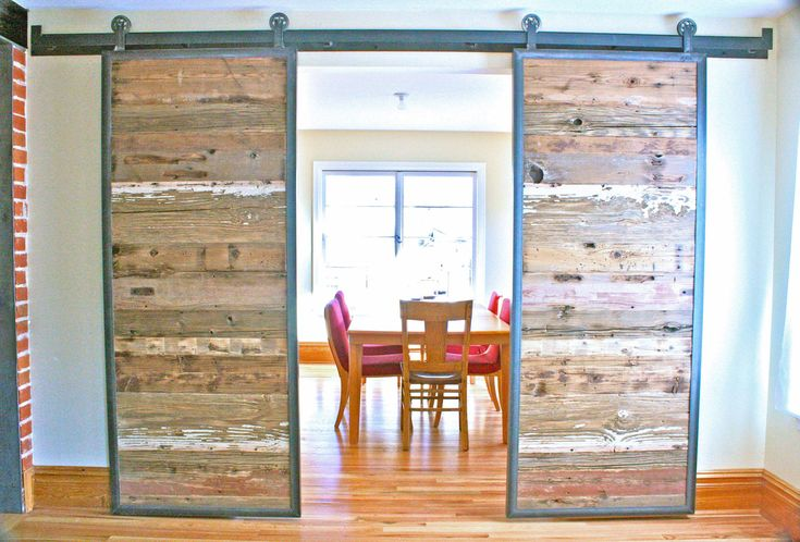 More like for a future home, but I find this a spectacular idea.    Barn Doors in Reclaimed Wood - Tracks Included. $1,950.00, via Etsy.