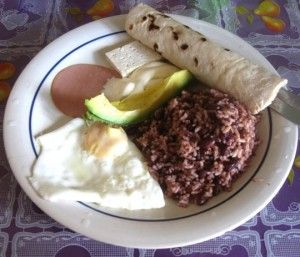 Typical Food in Nicaragua - Gallo Pinto (Rice and Beans), Egg, Tortilla, Avocado and Cheese.