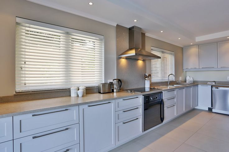 White wood venetian blinds installed by Aesthetic shutters and blinds <3