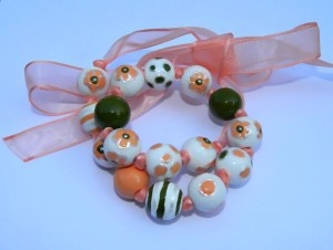 necklace with wooden beads, acrylic painting