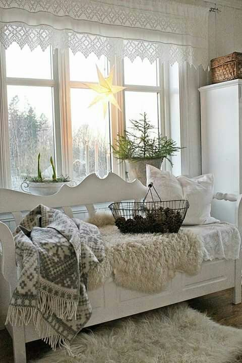 Romantic scene with lacy valance and white wooden furniture.