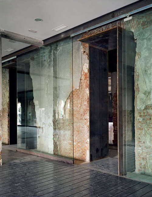 mindmadednoir:    The warehouse 17c in Madrid, Spain by Arturo Franco Office --- Rough textures behind glass