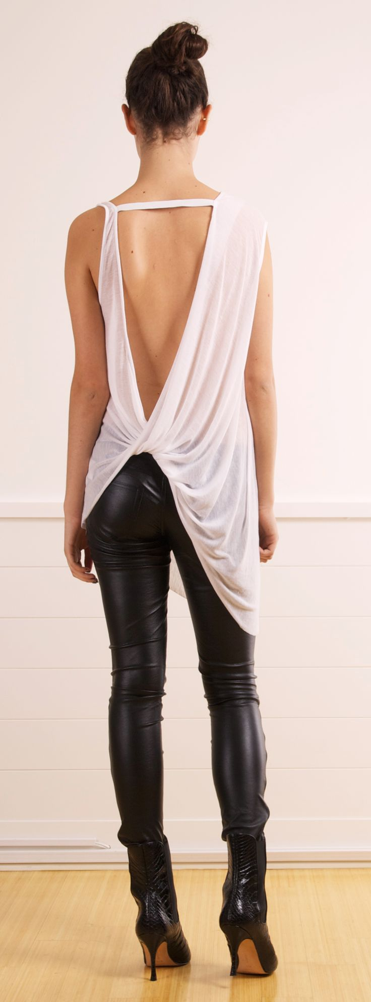 "HELMUT LANG TANK @SHOP-HERS. The flowing tank is an interesting contrast to the form fitting leather pants. It is a great outfit for ""ladies night"". All potential suitors, please form a queue!!!"