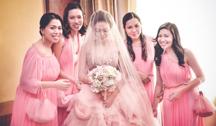 Lovely bridesmaids in pink dresses in a wedding at Haytt Manila ...