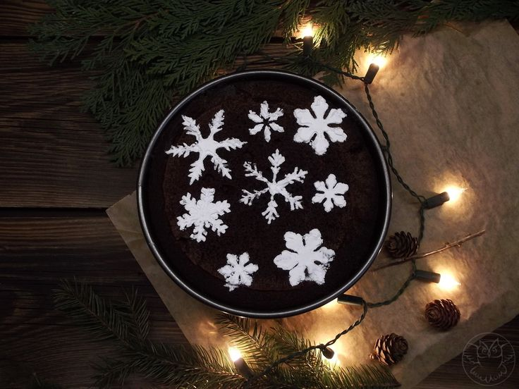 Chocolate cake with powdered sugar snowflakes